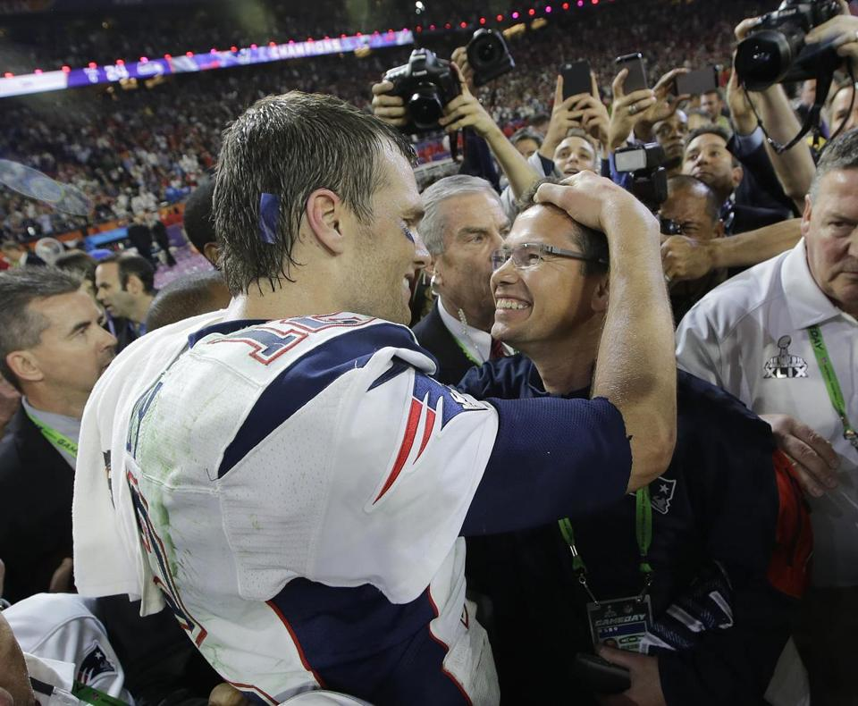 Patriots quarterback Tom Brady (left) celebrated with Alex Guerrero after the Patriots beat the Seahawks in Super Bowl XLIX in February.